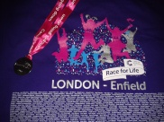 My t-shirt and medal - I completed my first 5K in 49 minutes!