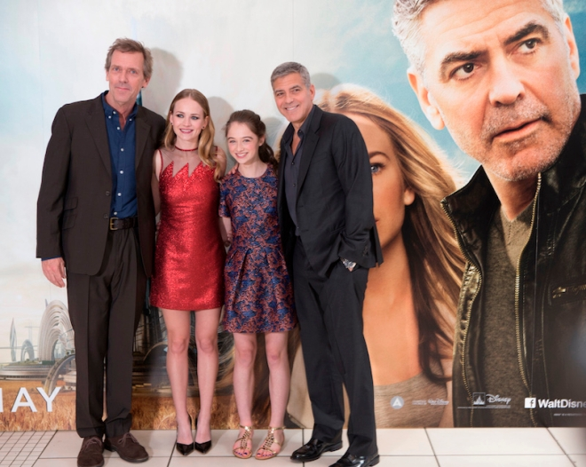 """Hugh Laurie, Brit Robertson, Raffey Cassidy and George Clooney attend the European premiere of Disney's """"Tomorrowland: A World Beyond"""" in Leicester Square on May 17, 2015 in London, UK"""